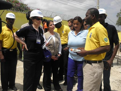 United Nations Development Program (UNDP) Administrator Helen Clark visited a joint UNDP, UMCOR Haiti, and Miyamoto International training site. Pictured in photo: Helen Clark (in black); Elizabeth Petheo, Head of Mission, UMCOR Haiti; Guilaine Victor, Program Manager/Senior Associate, Miyamoto International; and Canes Girolien, Evaluation Team Manager, UNDP CARMEN project. Photo: Guillaume Joachin, UNDP