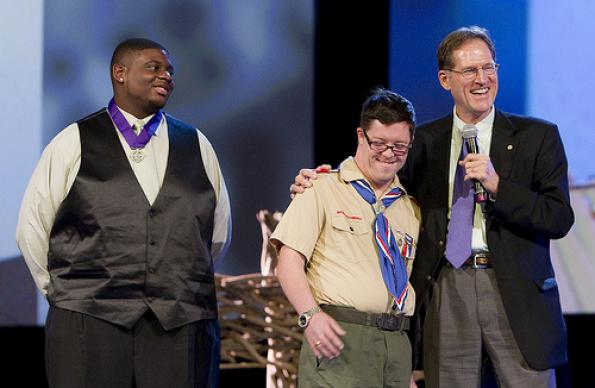Boy Scouts Justin Jackson (left) and Ryan Wilson receive the United Methodist Church's Good Samaritan Award from Larry Coppock during the 2012 United Methodist General Conference in Tampa, Fla. Coppock is director of Scouting Ministries at the General Commission on United Methodist Men. A UMNS photo by Mike DuBose.