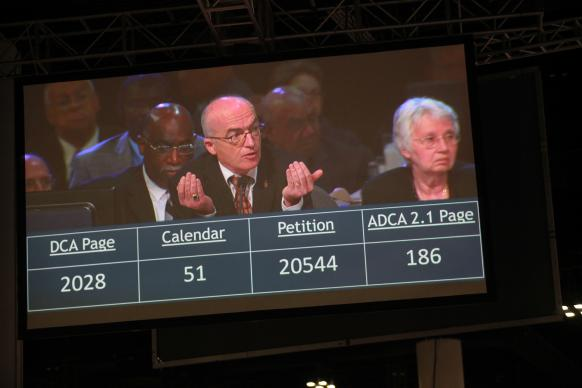 Bishop Patrick Streiff, projected on a large digital screen in the plenary hall, presides over a session at the 2012 United Methodist General Conference in Tampa, Fla. A UMNS photo by Kathleen Barry
