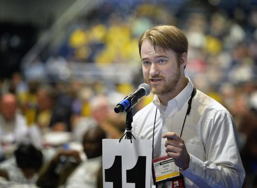 David Hosey, a delegate from the Baltimore-Washington Annual Conference, speaks in favor of divestment from corporations profiting from Israeli settlement of occupied Palestinian territories. A UMNS photo by Paul Jeffrey.