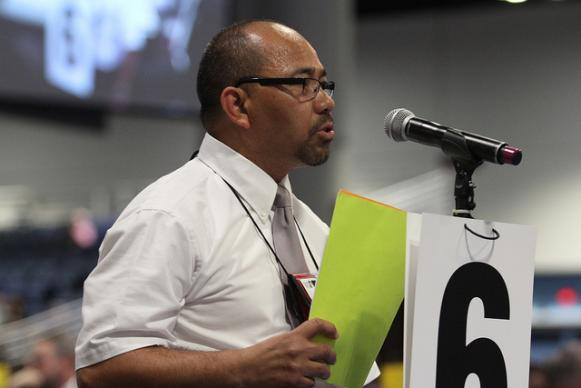 The Rev. Armando Arellano of the East Ohio Annual (regional) Conference addresses church restructuring on May 2 during the 2012 United Methodist General Conference in Tampa, Fla. A UMNS photo by Kathleen Barry
