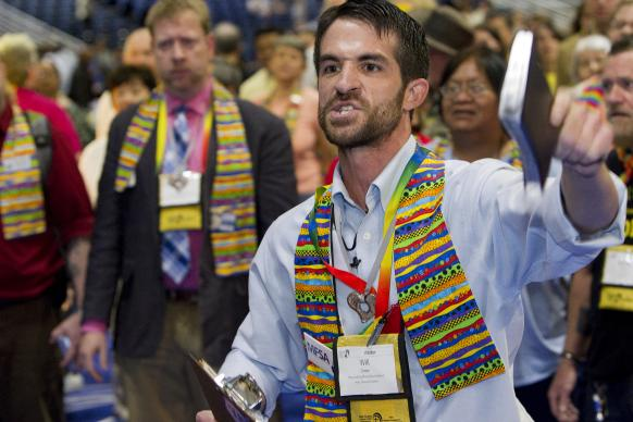 The Rev. Will Green, a visitor from Massachusetts, helps lead a protest calling for greater inclusiveness in the United Methodist Church on May 2 on the floor of the 2012 United Methodist General Conference in Tampa, Fla. A UMNS photo by Mike DuBose.