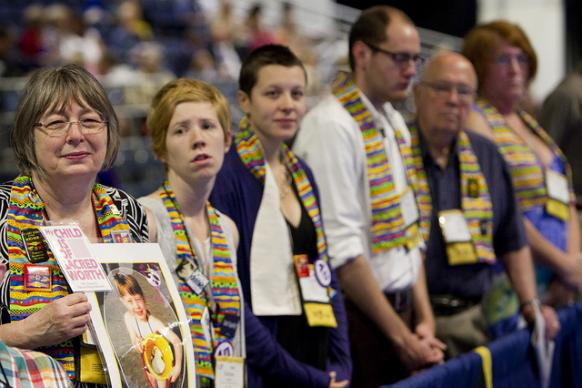 Protesters against the church's policies on sexuality stand in silent vigil during the 2012 United Methodist General Conference in Tampa, Fla. A UMNS photo by Mike DuBose.