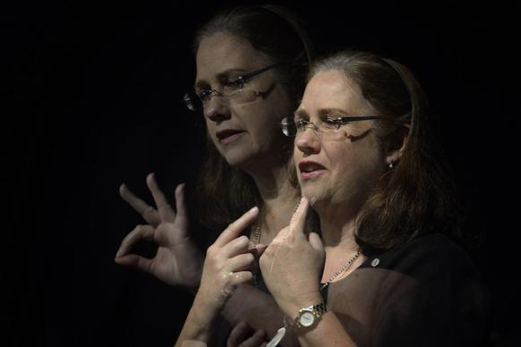 Angie Liston provides American Sign Language interpretation at the 2012 United Methodist General Conference in Tampa, Florida. Liston is a member of Morrison United Methodist Church in Leesburg, Florida. A double exposure for UMNS by Paul Jeffrey.