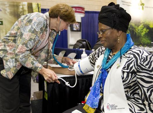 Parish nurse Susie Maridon-Crites (left) checks blood pressure for Deaconess Claris Skerritt during a health screening at the 2012 United Methodist General Conference in Tampa, Fla. A UMNS photo by Mike DuBose.