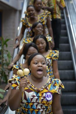 The Africa University Choir descends an escalator in Tampa, Florida, at the 2012 United Methodist General Conference. A UMNS photo by Paul Jeffrey.