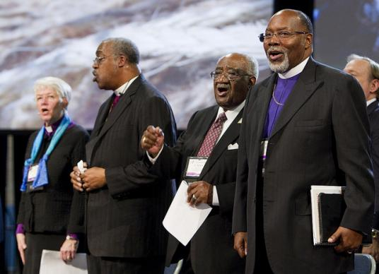 Pan-Methodist church leaders join together on May 1 at the 2012 United Methodist General Conference in Tampa, Fla. From left are: Bishop Sharon Zimmerman Rader, The United Methodist Church; Bishop Thomas Hoyt Jr., Christian Methodist Episcopal Church; the Rev. W. Robert Johnson III, African Methodist Episcopal Zion Church; and Bishop John F. White, African Methodist Episcopal Church. A UMNS photo by Mike DuBose.