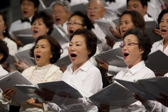 The choir from the Korean United Methodist Church of Atlanta sings during worship at the 2012 United Methodist General Conference in Tampa, Fla. A UMNS photo by Mike DuBose.