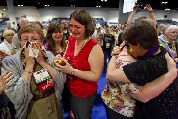Delegate Jo Ann Carlotto (left) of the New England Conference wipes her eyes with a rainbow stole after delegates voted to maintain the United Methodist Church's stance on sexuality during the denomination's at 2012 General Conference in Tampa, Fla. A UMNS photo by Mike DuBose.
