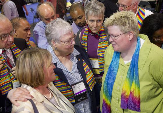 The Rev. Amy DeLong (right) negotiates with Bishops Rosemarie Wenner (left foreground) and Judith Craig to end a stand-off over the United Methodist Church's inclusivity during the 2012 General Conference in Tampa, Fla. A UMNS photo by Mike DuBose.