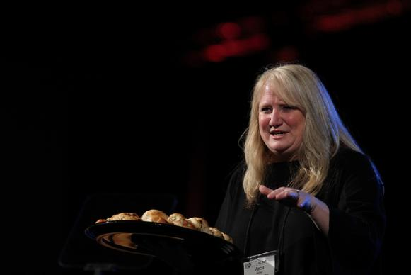 Marcia McFee, director of worship for the 2012 United Methodist General Conference in Tampa, Fla,. invites delegates and visitors to join the sharing of bread during evening worship on May e. A UMNS photo by Kathleen Barry