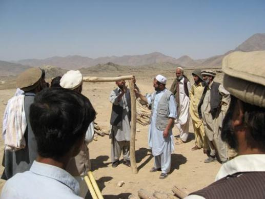 In Khaki Jabbar District, an isolated area in eastern Kabul Province, UMCOR staff explains the use of shelter materials so refugees can learn how to construct their own homes. Photo: UMCOR Afghanistan