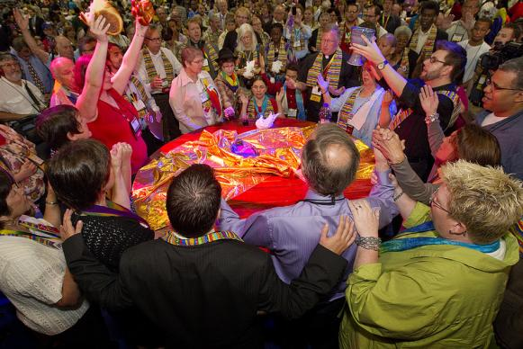 Protesters against the United Methodist Church's stance on sexuality prepare to serve Holy Communion inside the bar of the 2012 United Methodist General Conference in Tampa, Fla. The group occupied the conference's central table after delegates voted to maintain the denomination's position. A UMNS photo by Mike DuBose.