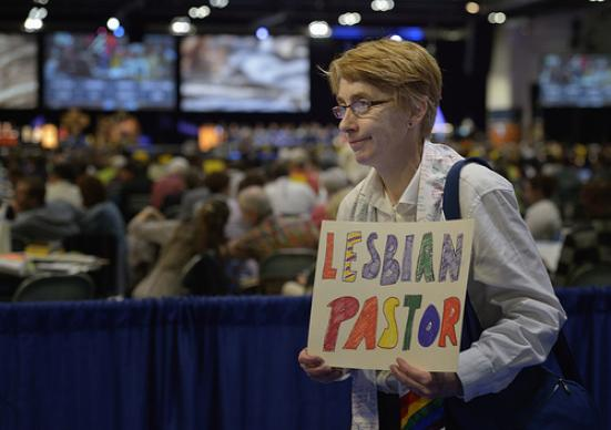 One of several demonstrators at the May 1 session of the 2012 United Methodist General Conference in Tampa, Fla,, calls on delegates to defeat or remove legislation that discriminates against people based on their sexual orientation. A UMNS photo by Paul Jeffrey.