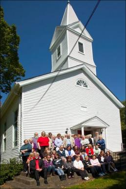 Members stands before Drakestown (N.J.) United Methodist Church for its 200th anniversary. The church and its new electric sign provided a beacon for storm-tossed New Jersey residents. Photo courtesy of Drakestown United Methodist Church.