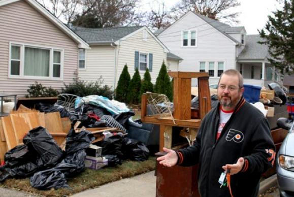 The Rev. Don Stevens sorts through his ruined belongings. Photo by Sushil Bhujbal.