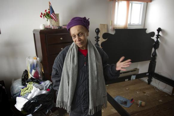 Margaret Lowe, 75, describes the damage caused by floodwaters from Hurricane Sandy at her home in Freeport, N.Y., on Long Island. The water buckled floors and ruined walls and furniture. Lowe is a member of Freeport United Methodist Church.
