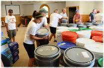Volunteers assemble cleaning buckets in this file photo on the website of the North Carolina Conference. A file photo by Bill Norton.By Barbara Dunlap-Berg*