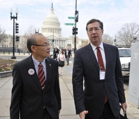 Bishop Robert T. Hoshibata (left) and Jim Winkler, chief executive of the United Methodist Board of Church and Society, walk together to the Imagine No Malaria conference on Capitol Hill in Washington Dec. 3, 2012.
