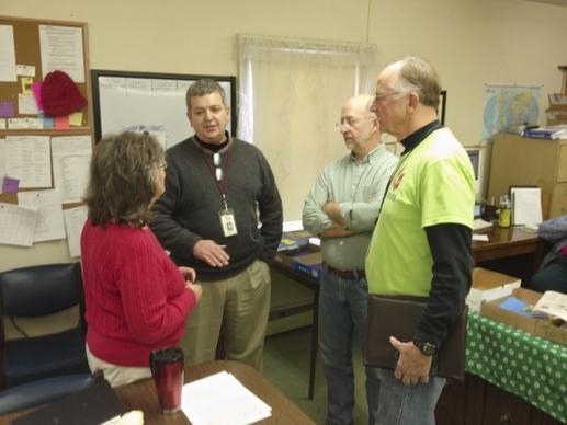 Peggy Racine, program and volunteer coordinator for the United Methodist Disaster Relief Center in Massapequa, N. Y.; Greg Forester, Northeast coordinator for Volunteers in Mission, the Rev. Jeff Wells of Community United Methodist Church in Massapequa, and Warren Ferry, a work team leader, discuss volunteer coordination.