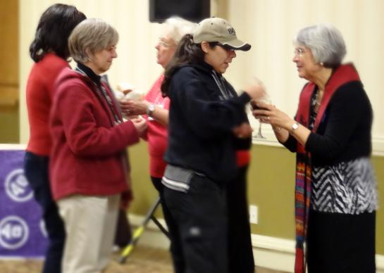 Rev. Liz Lopez, right, serves communion after her rousing sermon to lead off the Annual Conference COSROW training in Nashville recently.