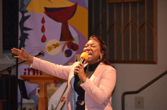 The Rev. Cynthia Wilson sings during the memorial service at the Black Methodists for Church Renewal Annual Meeting last week as Bishop Jonathan Keaton prepares to preach. Photos for UMNS by the Rev. Maidstone Mulenga.