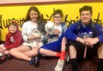 From left, siblings Taylor, Haylee, Clayton and Zane Chiarello grin with their pooches after the storm. Photo courtesy of the Rev. Randy Shrauner.