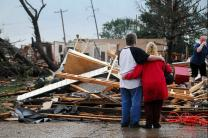 Residents of Oklahoma neighborhood hit by the tornado survey the damage. A web-only photo courtesy of The Transcript/Kyle Phillips.