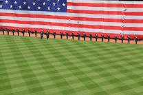 Members of the U.S. military salute the flag during the National Anthem before a Boston Red Sox game on April 15. UMNS photos by Neftali Ramirez.