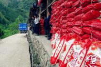 After two weeks of instant noodles, villagers affected by the April 20 earthquake in China finally have rice. Amity is helping distribute rice and other emergency supplies to households. UMNS Photo courtesy of the Amity Foundation