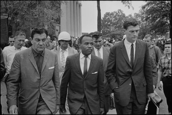 James Meredith walks to class at the University of Mississippi accompanied by U.S. marshals in this 1962 file photo. Photo from the Library of Congress/Wikipedia Commons.