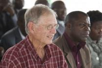 The Rev. Burl G. Kreps (left) joins others for the kickoff celebration of a mosquito net distribution by the United Methodist Church's Imagine No Malaria campaign in Bom Jesus, Angola. A UMNS photo by Mike DuBose.