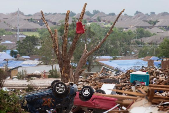 Just a few hundred yards separates zones of total devastation, damaged roofs and undamaged homes following a massive tornado in Moore, Okla. A UMNS photo by Mike DuBose