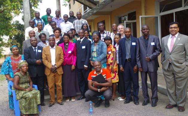 United Methodist West Congo Annual Conference leaders attending the seminar on management and resolution of conflict in Kinshasa pose for a group photo with the Rev. Neal Christie and the Rev. Clayton Childers of the United Methodist Board of Church and Society. A UMNS photo by Pierre Omadjela.