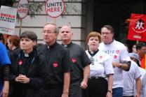 (From left) the Revs. Marti Scott, Chuck Dauhm, Michael Shanahan and C.J. Hawking line up (risking arrest) in support of Hyatt workers in Chicago. A web-only photo by Luis Juarez