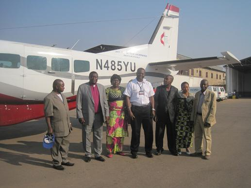 Pilot Gaston Ntambo (center) prepares for the first flight of the new Wings of the Morning aircraft inside the Democratic Republic of Congo, taking a delegation from Lubumbashi to Kongolo for a meeting of the Tanganyika Annual Conference. A UMNS photo courtesy of Bishop Nkulu Ntanda Ntambo.
