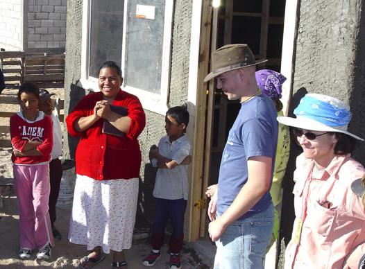 Willie Tichenor (second from right) at dedication of new home in Juarez, Mexico in 2005. He had joined a mission trip there in between chemotherapy treatments. Photo courtesy of Lisa Tichenor.