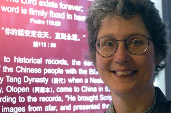 """Diane Allen, coordinator of the China Program for the United Methodist Board of Global Ministries, visits the Chinese Bible ministry exhibition at the Cathedral of Saint John the Divine in New York City. The """"A Lamp to My Feet, A Light to My Path"""" Bible ministry exhibition from China is intended as both an educational tool and vehicle for friendship. A UMNS photo by John Goodwin."""