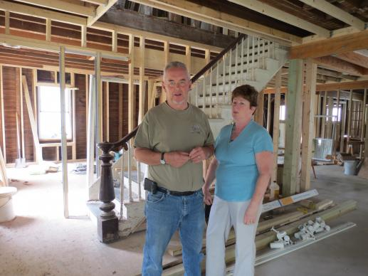Gary and Jackie Wilkie describe work that needs to be completed in the parsonage in Prattsville, N.Y., two years after the community was ravaged by Hurricane Irene.