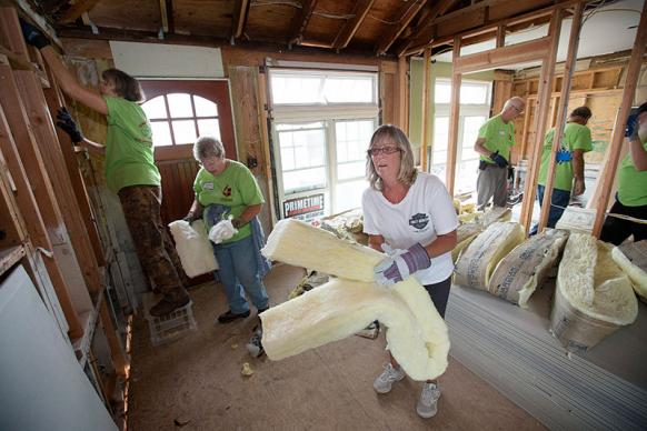 Lisa Mentges (center) works with a United Methodist volunteer team to repair her home in Long Beach, N.Y., after it was flooded by Hurricane Sandy. The volunteers are from the California-Pacific Annual (regional) Conference. UMNS photos by Mike DuBose.