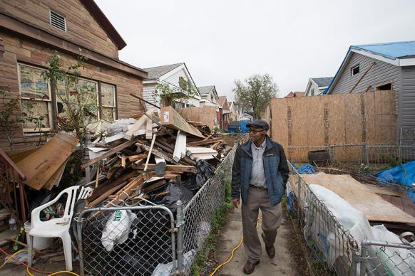 The Rev. Wesley Daniels checks on the work of a United Methodist volunteer team at a home in the Sheepshead Bay area of Brooklyn in New York that was flooded by Hurricane Sandy. Daniels manages the New York Conference disaster response office hosted by St. Mark's United Methodist Church in Brooklyn. UMNS photos by Mike DuBose.