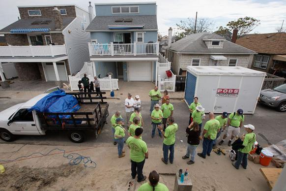 A United Methodist volunteer team from the California-Pacific Annual (regional) Conference receives instructions before beginning work on a home damaged by Hurricane Sandy in Long Beach, N.Y., a part of Long Island.