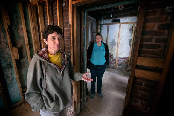 Bobbie Ridgely (left) and Katie Quigley discuss the progress of repairs at a home damaged by Hurricane Sandy in Atlantic City, N.J. They work for A Future With Hope, a long-term recovery program of the Greater New Jersey Conference of The United Methodist Church. UMNS photos by Mike DuBose.