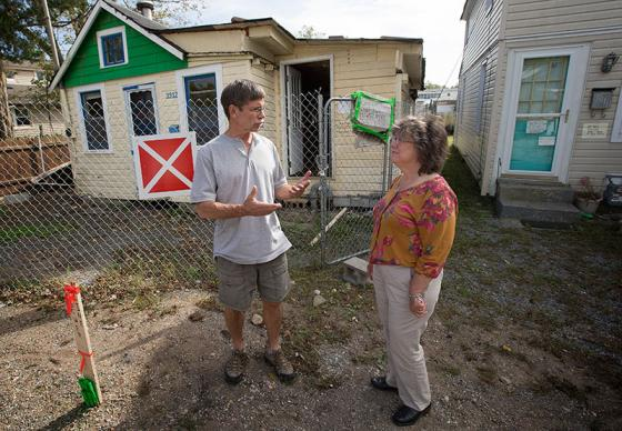 The Rev. Tom Vencuss (left) and Peggy Racine look over a Seaford, N.Y., home marked with a sign designating it as unsafe to enter after it was damaged by Hurricane Sandy. Vencuss is Sandy recovery manager for the New York Annual (regional) Conference, and Racine is the Long Island Sandy site coordinator.