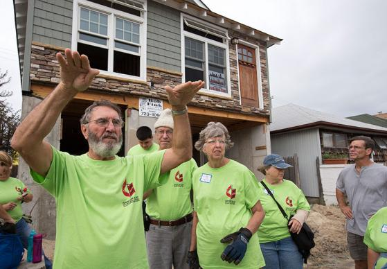 Don Howald (left) gives instructions to a United Methodist volunteer team from the California-Pacific Annual (regional) Conference as the group prepares to work on a home damaged by Hurricane Sandy in Long Beach, N.Y., a part of Long Island. The home is elevated on concrete pilings, raising it above neighboring homes. UMNS photos by Mike DuBose.