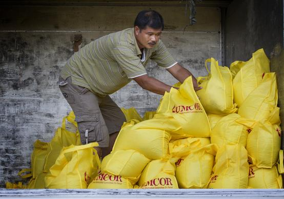 The Rev. Alan Cabas helps load a truck at the offices of the United Methodist Committee on Relief in Manila with relief supplies for survivors of Typhoon Haiyan in the Philippines.