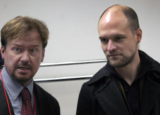 The Rev. Frank Schaefer (left) and his son Tim stand together during the Nov. 18 church trial. A UMNS photo by Kathy L. Gilbert.