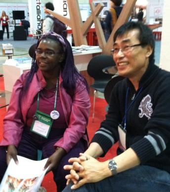 The Rev. Thomas Kim, right, visits with the Rev. Nyambura Njoroge, a World Council of Churches staff member, during the 10th assembly in Busan, Korea. UMNS photo courtesy of Thomas Kim