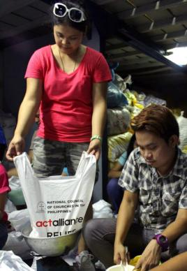 Volunteers help the National Council of Churches in the Philippines and ACT Alliance repack goods intended for relief in the typhoon-affected areas in Central Visayas.