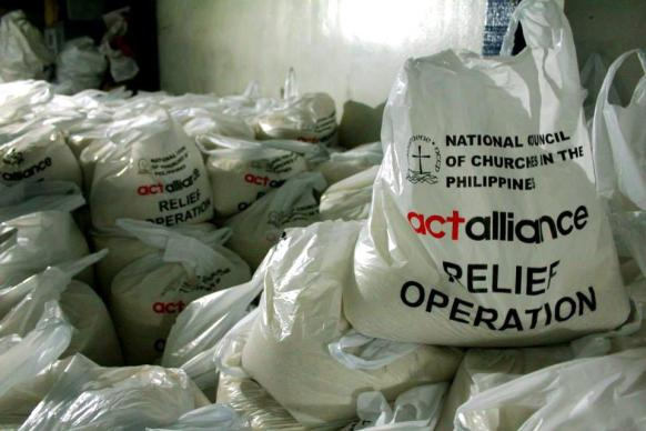 Bags of relief supplies gathered through the National Council of Churches in the Philippines and the ACT Alliance are ready for shipping to typhoon survivors.